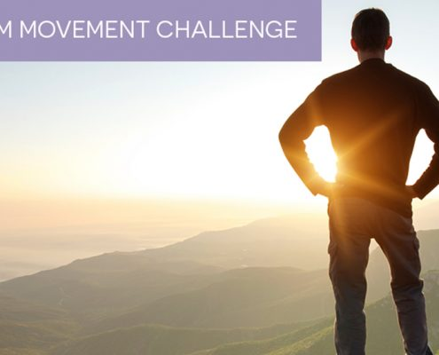 A man standing at the top of a mountain, watching the sun set after practing movement for pain care control and management