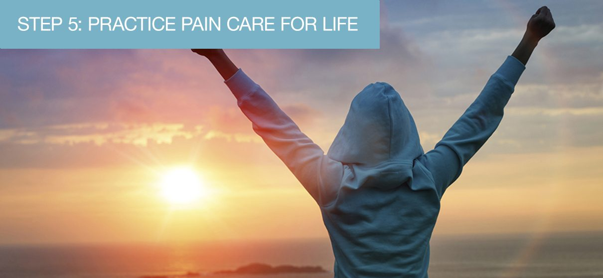 A woman at the beach with her arms stretched up to the sky in victory after going through the First 5 Steps and her success with pain care management and control